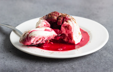 Cottage cheese dessert (jelly or panna cotta) with cherry sauce and cocoa. Healthy breakfast or dessert.