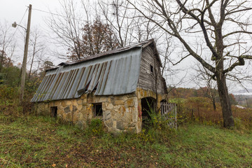 Angled view of vintage barn on abandoned property