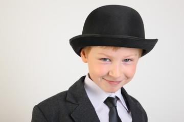 hat, boy, smile, school clothes, portrait, boy, child, schoolboy with a phone, artist, actor, boy actor, young model, portrait boy, school suit, school uniform, tie, conversation, blond, posing