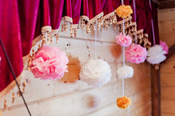 Festive decoration of paper pink and white pompons