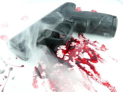 Murder scene - gun with blood on white background, close-up.