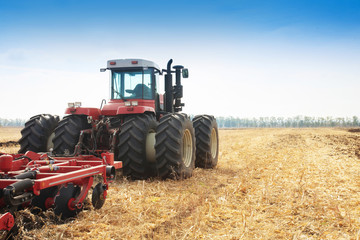 Wall Mural - Modern tractor in the field during planting. The concept of agricultural industry.