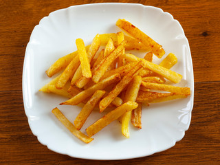 fried fries on a plate cooked at home