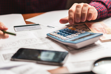 buisnessman counting earnings with a calculator b