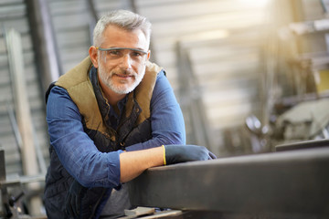 Portrait of middle-aged ironworker in workshop
