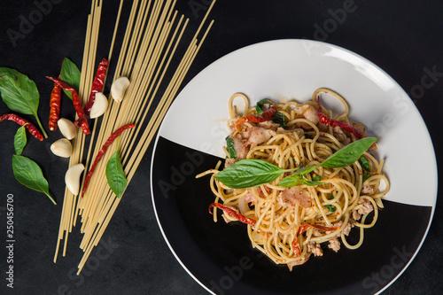 Spaghetti with spicy pork in dish