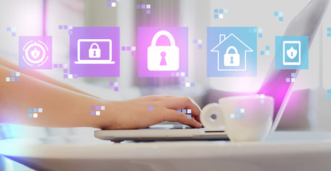 Cyber security with woman using a laptop on a coffee table  Wall mural