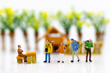 Miniature people : Immigration system for tourists when leaving the country. Image use for holiday travel, business concept.