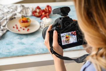 Female food photographer working in home studio