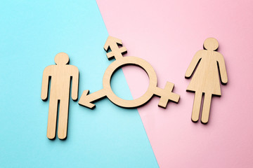 Obraz Female and male figures with symbol of transgender on color background - fototapety do salonu