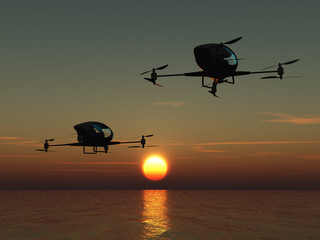 Two manned drones flying over the sea