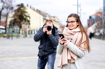 Young female model being photographed in the street