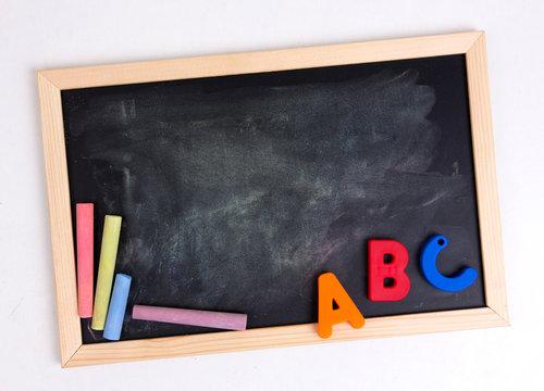 Colorful Alphabet On A Blackboard Or Chalkboard