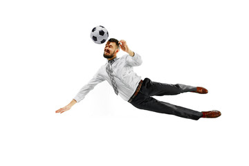 Full length shot of a young businessman playing football isolated on white background.