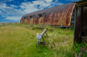 Rusted out building on cow ranch Mauna Kea