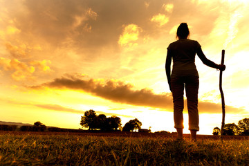 Pilgrim woman at Sunset