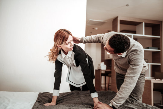 Client of hotel starting sexual harassment of young maid