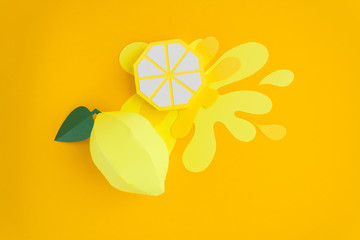 Fruit made of paper. Yellow background. There's room for writing. Tropics. Flat lay. Lemon.