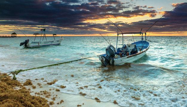 A fisherman prepares for his day at sea, Akumal Bay, Mexico