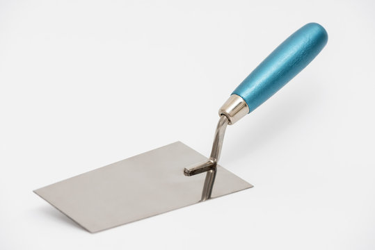 Construction trowel on a white background.