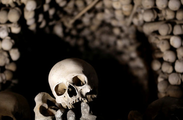 Medieval human skulls and bones are piled up at the Sedlec Ossuary in Kutna Hora