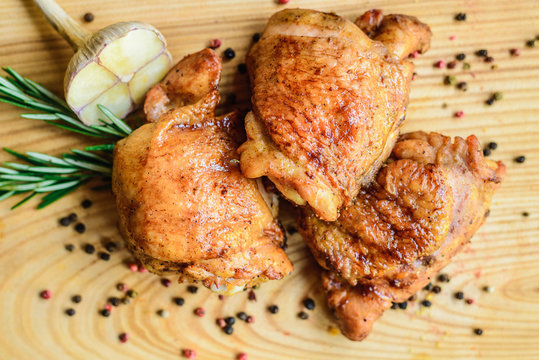 fried chicken thighs on a wooden board
