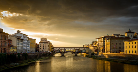 Aluminium Prints Florence Ponte Vecchio in Florence, Italy at a cloudy sunset