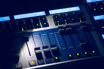 Professional lighting engineer console at concert. Remote control for sound engineer. Professional audio sound mixer console and music equipment, electronic device. Concert lighting engineer desk