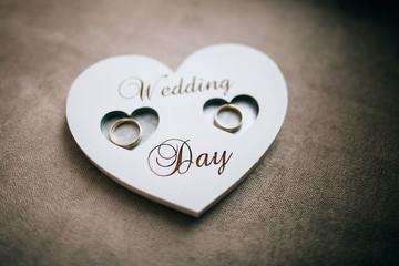 Handmade wooden heart for the wedding rings