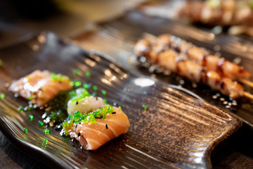 Salmon and sea bream sushi and tuna skewers of typical Japanese cuisine