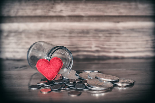 Red heart with coins. concept pay attention in saving.