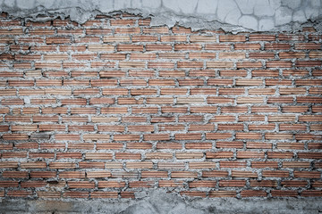 Unfinished brick wall plastering background with copy space. Under plastering brick wall texture as...