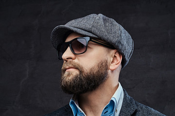5f38982216f75 Close-up portrait of a successful stylish man in sunglasses wearing a beret  and jacket