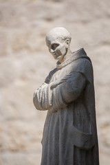 Illuminated monk statue in Cartuja monastery, Burgos, Spain