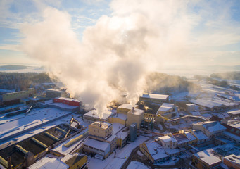 Aerial view to smoking stacks from industrial area near Pilsen. Air pollution and climate change theme. Power and fuel generation in Czech Republic, European Union.