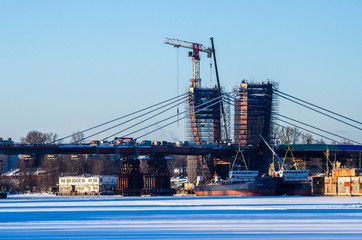 Construction of cable suspension bridge over the river.