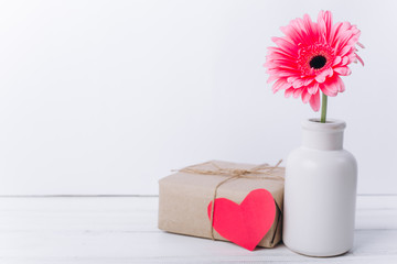 Mother's day concept.Vase with flower and gift.