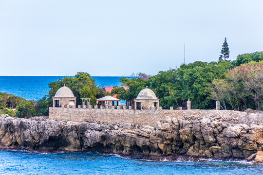 A stone wall and observation points over the sea on the coast of Haiti
