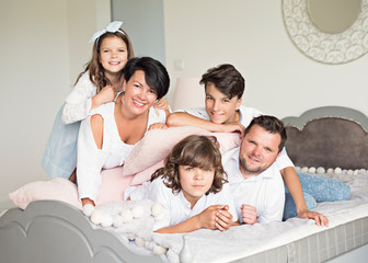 Fototapeta  Photo of four members adopted family lying floor toothy smiling fluffy carpet cozy apartments  obraz