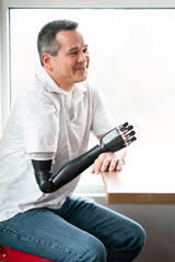 Portrait of man with robotic arm