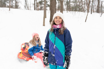 Two girls play in snow