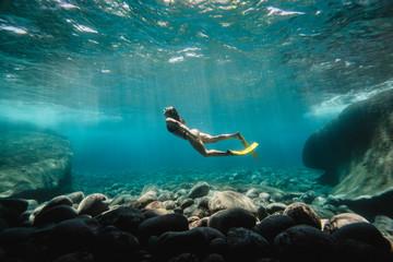 Side view of woman diving underwater in sea