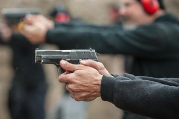 Group of civilian practice gun shooting on outdoor shooting range Wall mural