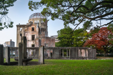 The ruin of the Atomic Bomb Dome in Hiroshima at sunset on the side of Motoyasu River in Japan, a symbol of the destruction of the atomic blast in world war two.