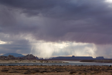 Scenic view of Lake Powell against storm clouds