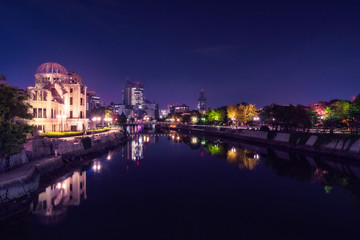 Hiroshima Cityscape by night with the Atomic Bomb Dome on the side of Motoyasu River in Japan.