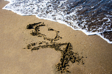 Romantic art on the sand on the beach of the Black sea