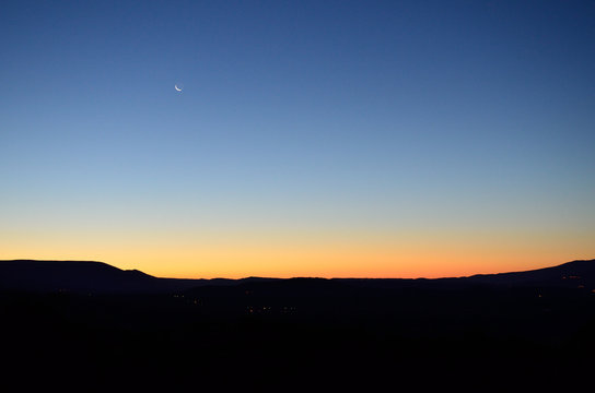 sunset with sliver of moon
