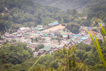 Doi Pui's Hmong ethnic hill-tribe village, aerial view from the cliff with green forest on the mountain background. Doi Pui Hmong tribal village is located on Doi Suthep-Pui national park, Chiang Mai.