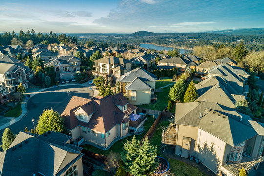Beautiful luxury neighborhood in the Pacific Northwest photographed at sunset from the air